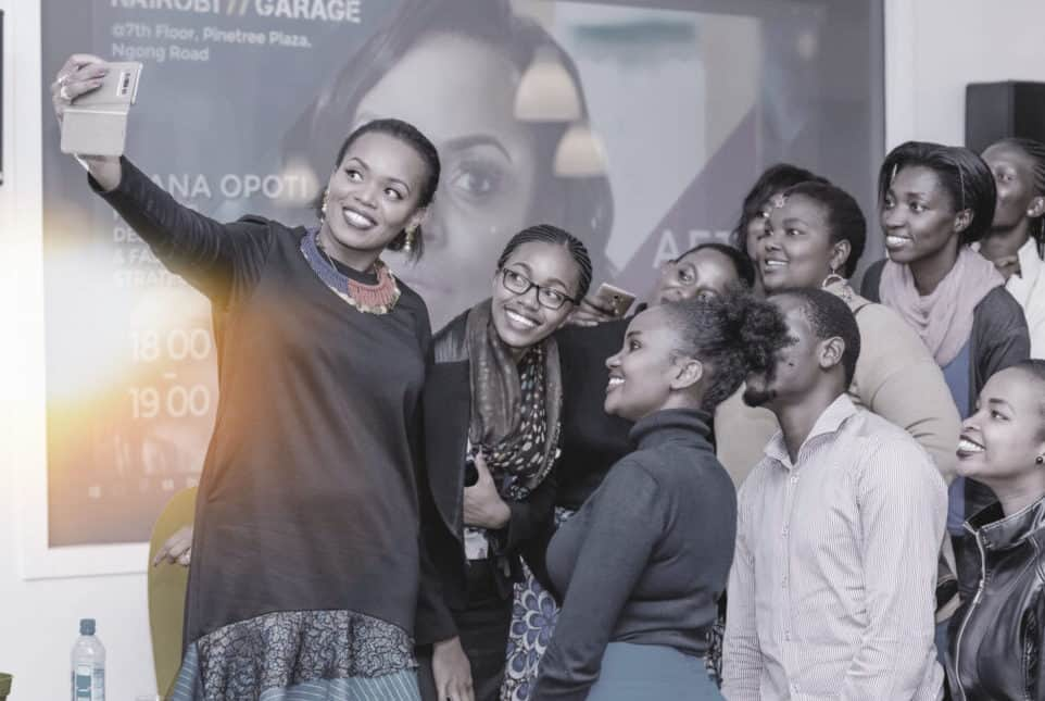 Diana Opoti taking a selfie with After Office Hours attendees