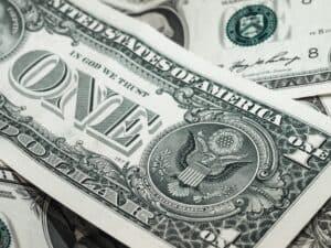 Image of one dollar bills source on pexels
