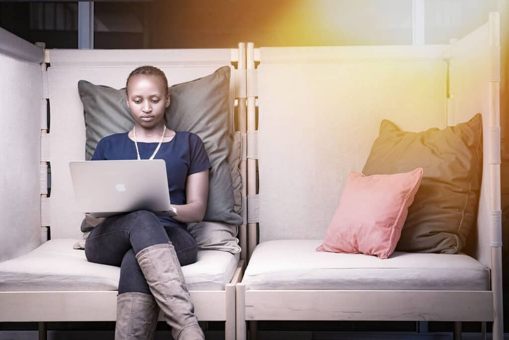 African lady seating at a coworking space at Nairobi Garage